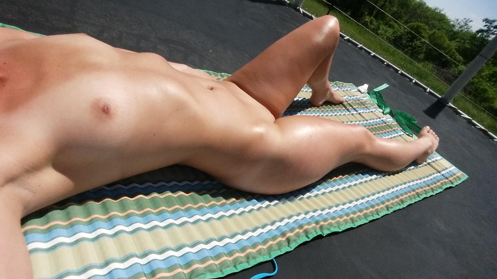Nude sun tanning girls a beach spy cam