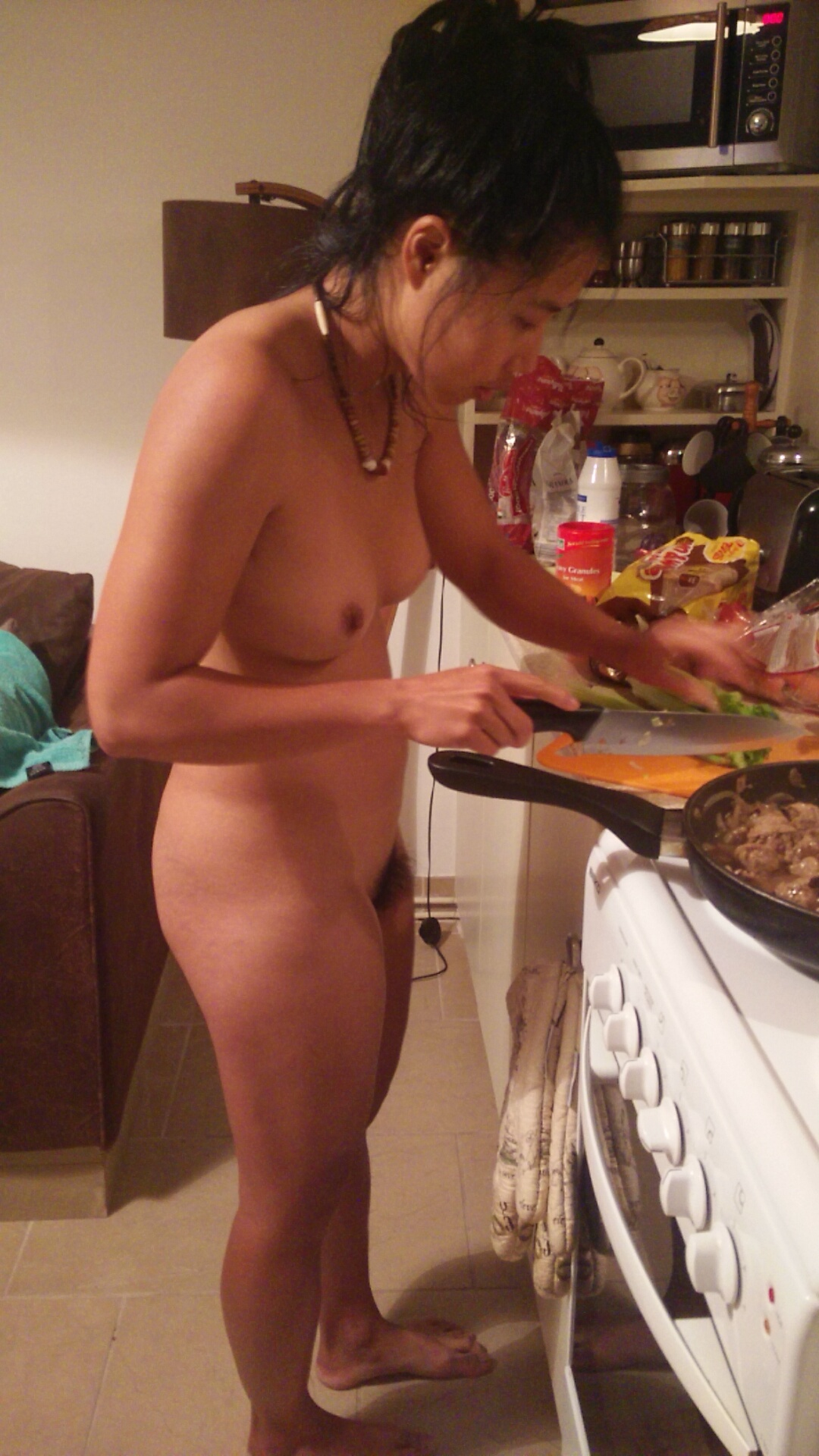 Blonde wife naked cooking
